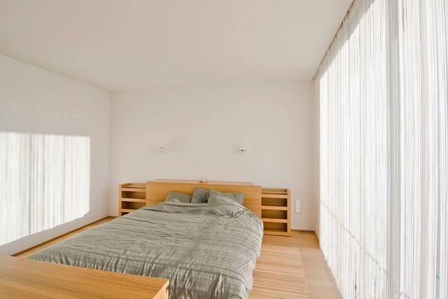 Strakke witte slaapkamer